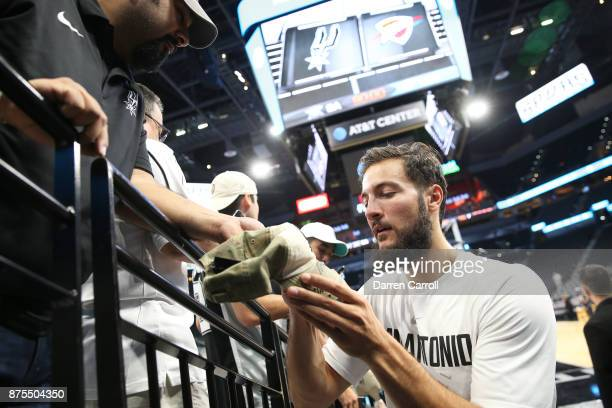 Joffrey Lauvergne of the San Antonio Spurs signs autographs before the game against the Oklahoma City Thunder on November 17 2017 at the ATT Center...