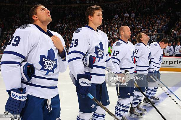 Joffrey Lupul Keith Aulie Tim Connolly Phil Kessel and Dion Phaneuf of the Toronto Maple Leafs stand on the blueline during the singing of the...