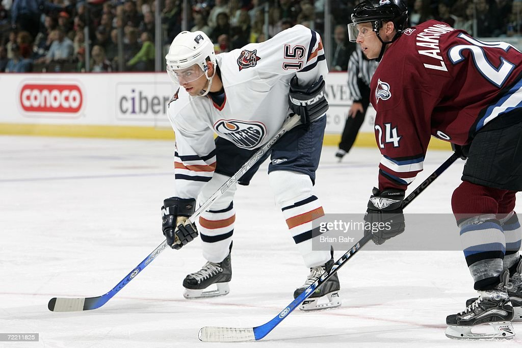 Joffrey Lupul #15 of the Edmonton Oilers looks on against Antti Laaksonen#24 of the Colorado Avalanche on October 14, 2006 at the Pepsi Center in Denver, Colorado. The Oilers won 4-3.