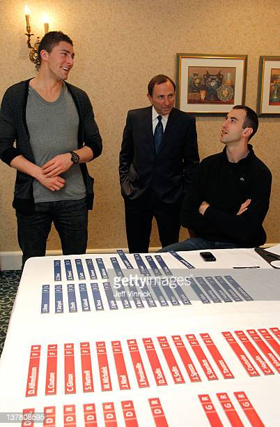 Joffrey Lupul of the Toronto Maple Leafs and Team Chara NHL Commissioner and Captain Zdeno Chara of the Boston Bruins and Team Chara look on at the...