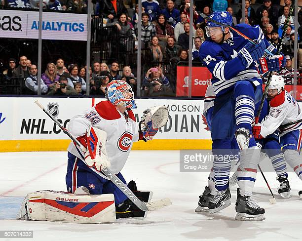Joffrey Lupul of the Toronto Maple Leafs jumps in front of Mike Condon of the Montreal Canadiens during game action on January 23 2016 at Air Canada...