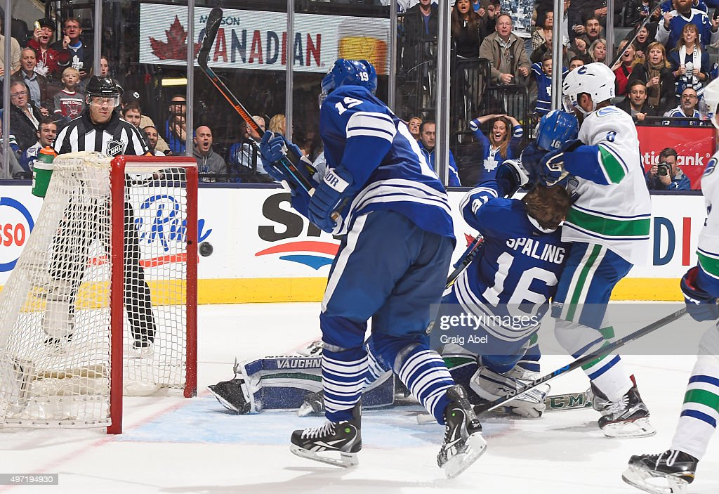 Joffrey Lupul #19 of the Toronto Maple Leafs scores a third period goal on Ryan Miller #30 of the Vancouver Canucks during NHL game action November 14, 2015 at Air Canada Centre in Toronto, Ontario, Canada.