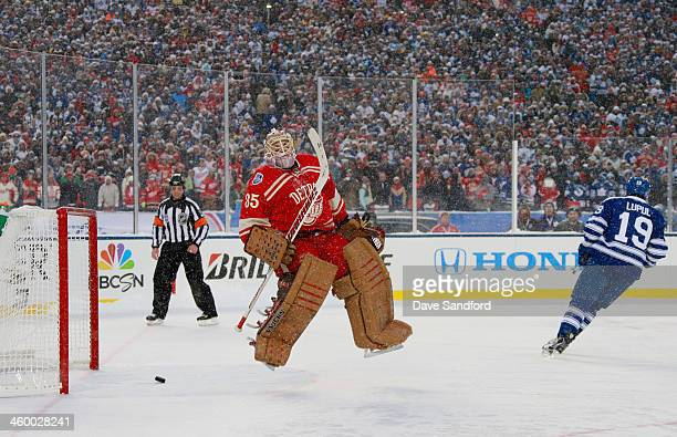 Joffrey Lupul of the Toronto Maple Leafs scores on goaltender Jimmy Howard of the Detroit Red Wings during shootout overtime during the 2014...