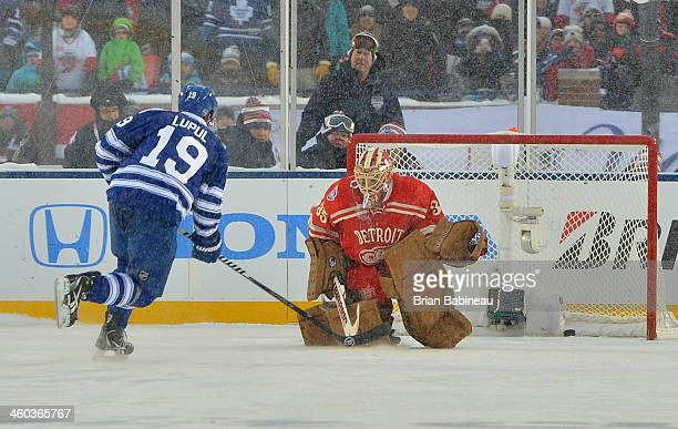 Joffrey Lupul of the Toronto Maple Leafs scores on goaltender Jimmy Howard of the Detroit Red Wings during shootout overtime of the 2014 Bridgestone...