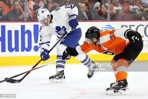 Joffrey Lupul of the Toronto Maple Leafs shoots in front of Mark Streit of the Philadelphia Flyers during the first period at Wells Fargo Center on...