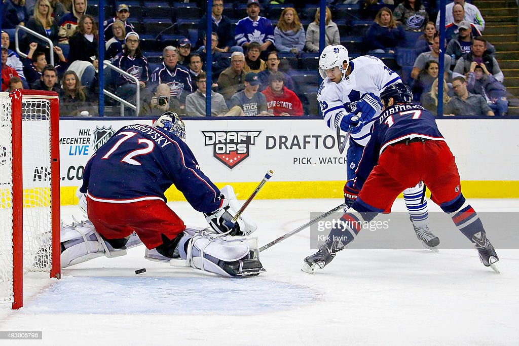 Joffrey Lupul #19 of the Toronto Maple Leafs shoots the puck past Brandon Dubinsky #17 of the Columbus Blue Jackets and Sergei Bobrovsky #72 of the Columbus Blue Jackets to score the game winning goal during the third period on October 16, 2015 at Nationwide Arena in Columbus, Ohio. Toronto defeated Columbus 6-3.