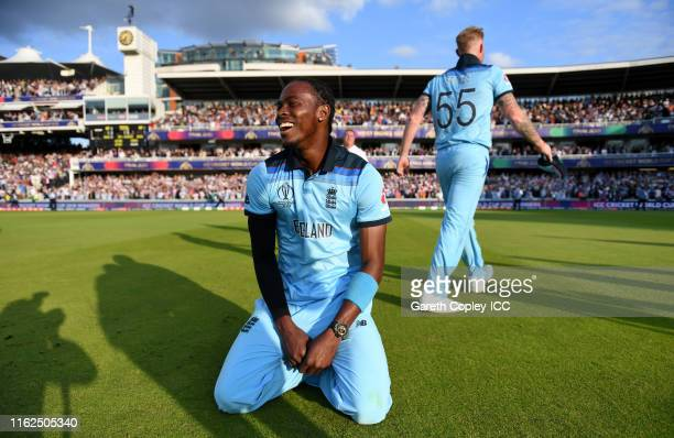 Jofra Archer and Ben Stokes of England celebrate after winning the Final of the ICC Cricket World Cup 2019 between New Zealand and England at Lord's...