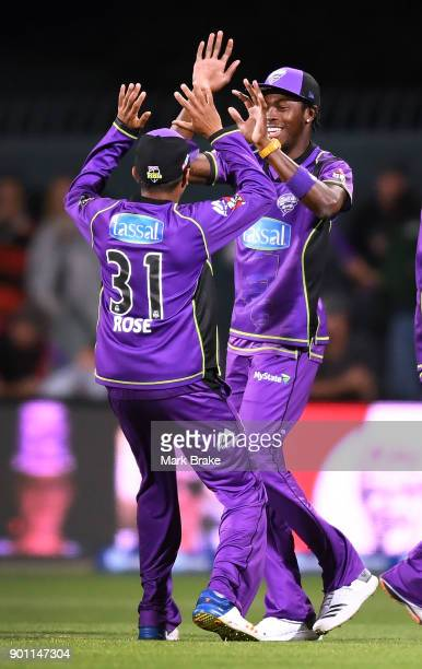 Jofra Archer and Clive Rose of the Hobart Hurricanes celebrate a wicket during the Big Bash League match between the Hobart Hurricanes and the...