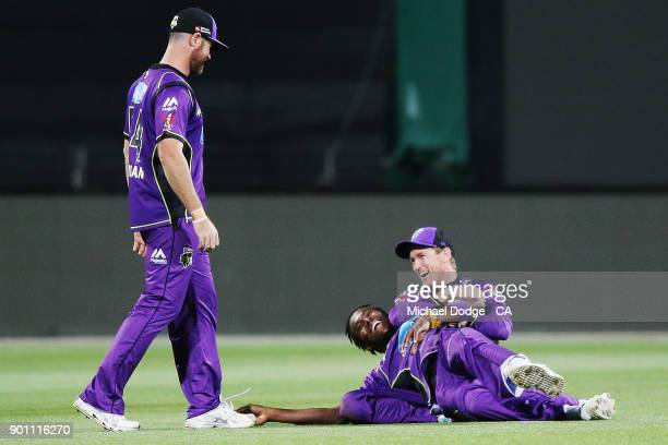 Jofra Archer and George Bailey of the Hurricanes celebrate the win during the Big Bash League match between the Hobart Hurricanes and the Adelaide...