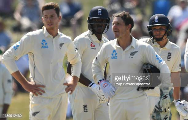Jofra Archer and Sam Curran of England look on during a review during day five of the first Test match between New Zealand and England at Bay Oval on...