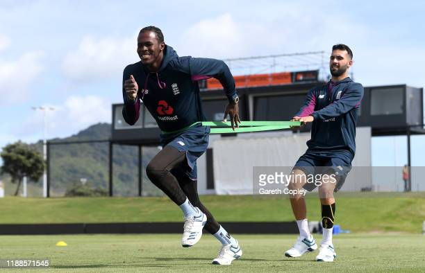 Jofra Archer and Saqib Mahmood of England warm up during a nets session at Bay Oval on November 19 2019 in Mount Maunganui New Zealand