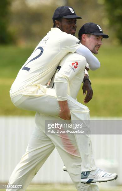 Jofra Archer is carried by Rory Burns of England to the dressing room at the luncheon interval at Cobham Oval on November 17 2019 in Whangarei New...