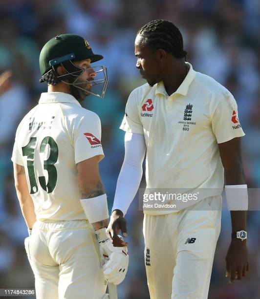 Jofra Archer of England and Matthew Wade of Australia have a chat during Day Four of the 5th Specsavers Ashes Test between England and Australia at...