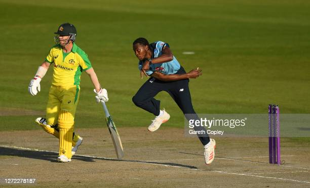 Jofra Archer of England bowls watched on by David Warner of Australia during the 2nd Royal London One Day International Series match between England...