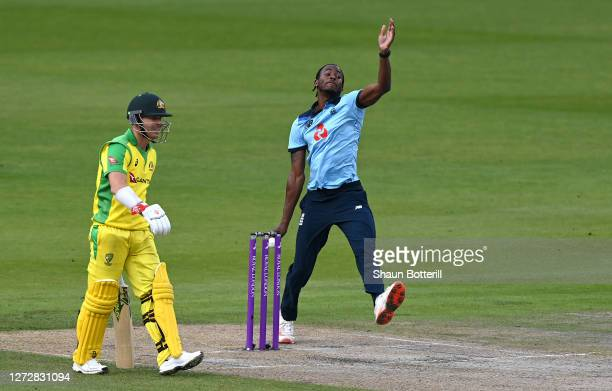 Jofra Archer of England bowls watched on by David Warner of Australia during the 3rd Royal London One Day International Series match between England...