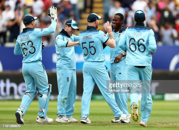 Jofra Archer of England celebates with his team mates after taking the wicket of Glenn Maxwell of Australia during the Semi-Final match of the ICC...