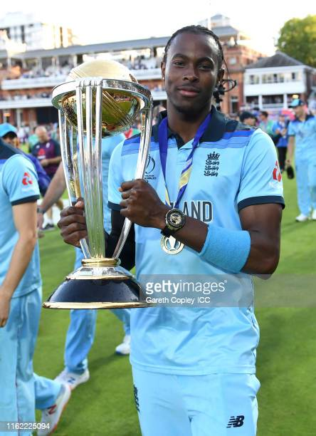 Jofra Archer of England celebrate with the trophy after winning the Final of the ICC Cricket World Cup 2019 between New Zealand and England at Lord's...