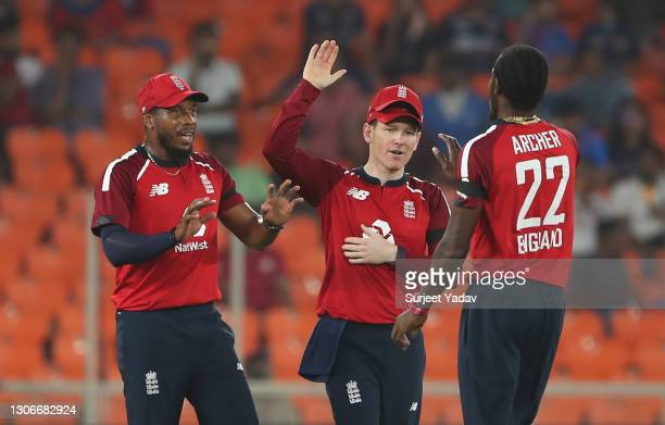 Jofra Archer of England celebrates after taking the wicket of Hardik Pandya of India with team mates Chris Jordan and Eoin Morgan during the 1st T20...