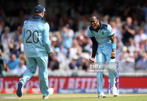 Jofra Archer of England celebrates taking the wicket of Faf du Plessis of South Africa with Jason Roy of England during the Group Stage match of the...