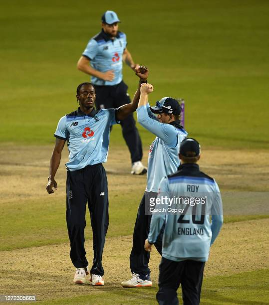 Jofra Archer of England celebrates the wicket of Mitchell Marsh of Australia with Eoin Morgan of England during the 2nd Royal London One Day...