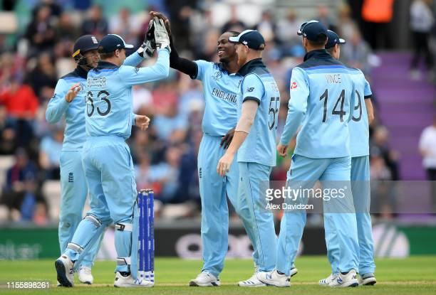 Jofra Archer of England celebrates the wicket of Sheldon Cottrell of West Indies with his teammates during the Group Stage match of the ICC Cricket...