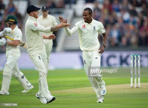 Jofra Archer of England celebrates with Ben Stokes after taking the wicket of Australian opener Marcus Harris during day one of the 3rd Ashes Test...