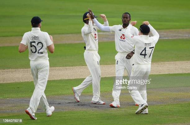 Jofra Archer of England celebrates with Ollie Pope and Dom Bess after taking the wicket of Abid Ali of Pakistan during Day One of the 1st...