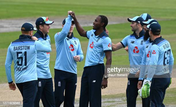 Jofra Archer of England celebrates with teammates after taking the wicket of David Warner of Australia during the 1st Royal London One Day...