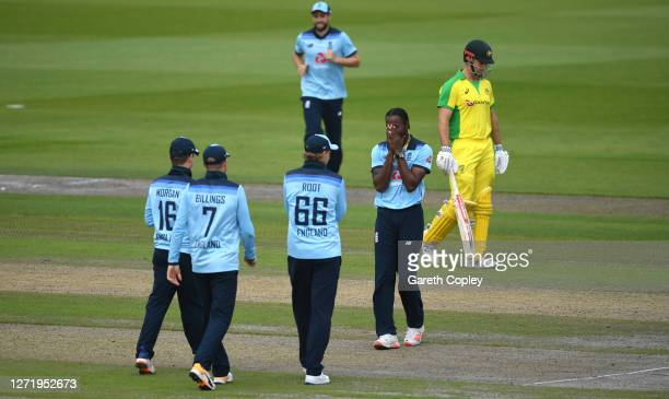 Jofra Archer of England celebrates with teammates after taking the wicket of Pat Cummins of Australia during the 1st Royal London One Day...