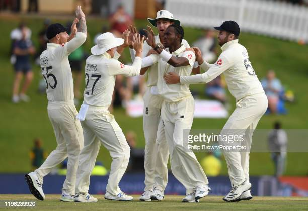 Jofra Archer of England celebrates with teammates including Ben Stokes and Stuart Broad after dismissing Faf du Plessis of South Africa during Day...
