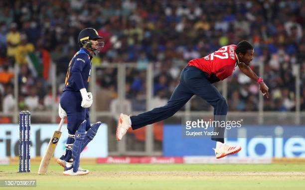 Jofra Archer of England in bowling action as Ishan Kishan of India looks on during the 2nd T20 International match between India and England at...