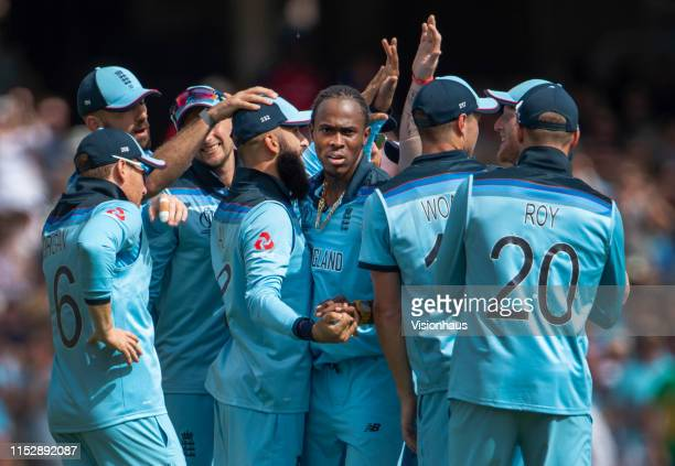 Jofra Archer of England is congratulated by his team mates after taking the wicket of Faf du Plessis of South Africa during the Group Stage match of...