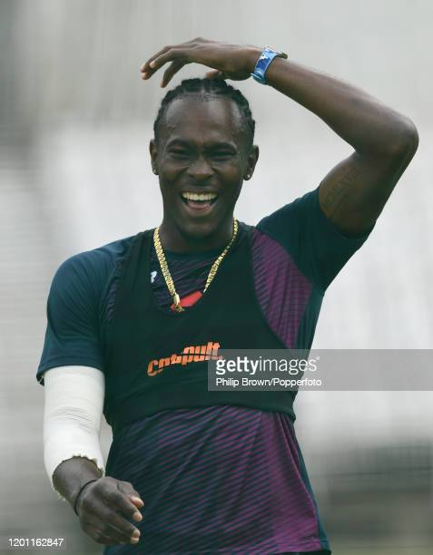 Jofra Archer of England laughs after bowling a ball in the nets at the Wanderers before the fourth Test match against South Africa on January 22,...