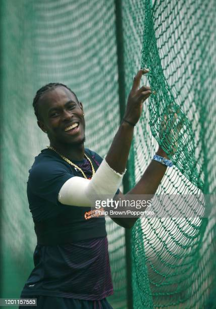 Jofra Archer of England laughs after bowling to Jos Buttler in the nets at the Wanderers before the fourth Test match against South Africa on January...