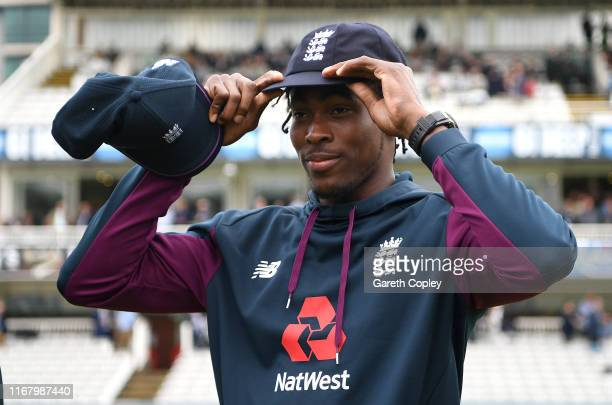 Jofra Archer of England tries on his test cap ahead of day one of the 2nd Specsavers Ashes Test match at Lord's Cricket Ground on August 14, 2019 in...