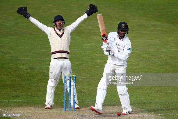 Jofra Archer of Sussex looks on as Surrey wicket keeper Billy Mead appeals during the Second Eleven Championship match between Sussex 2nd XI and...