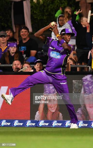 Jofra Archer of the Hobart Hurricanes catches Colin Ingram of the Adelaide Strikers during the Big Bash League match between the Hobart Hurricanes...