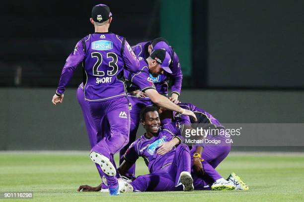 Jofra Archer of the Hurricanes and teammates celebrate the win during the Big Bash League match between the Hobart Hurricanes and the Adelaide...