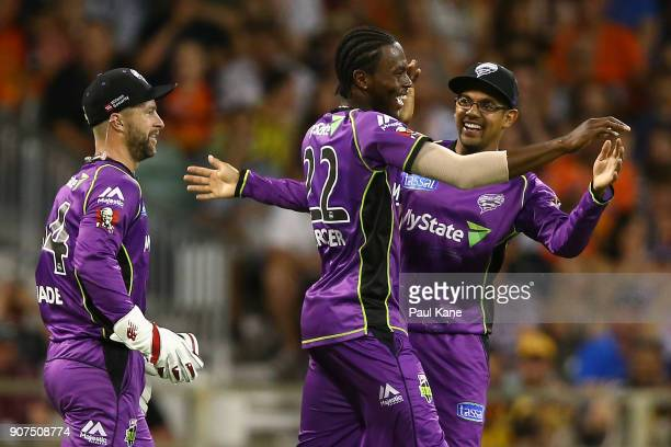 Jofra Archer of the Hurricanes celebrates with Clive Rose following a direct hit to run out Adam Voges of the Scorchers during the Big Bash League...