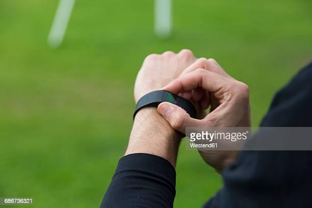 Jogger adjusting activity tracker