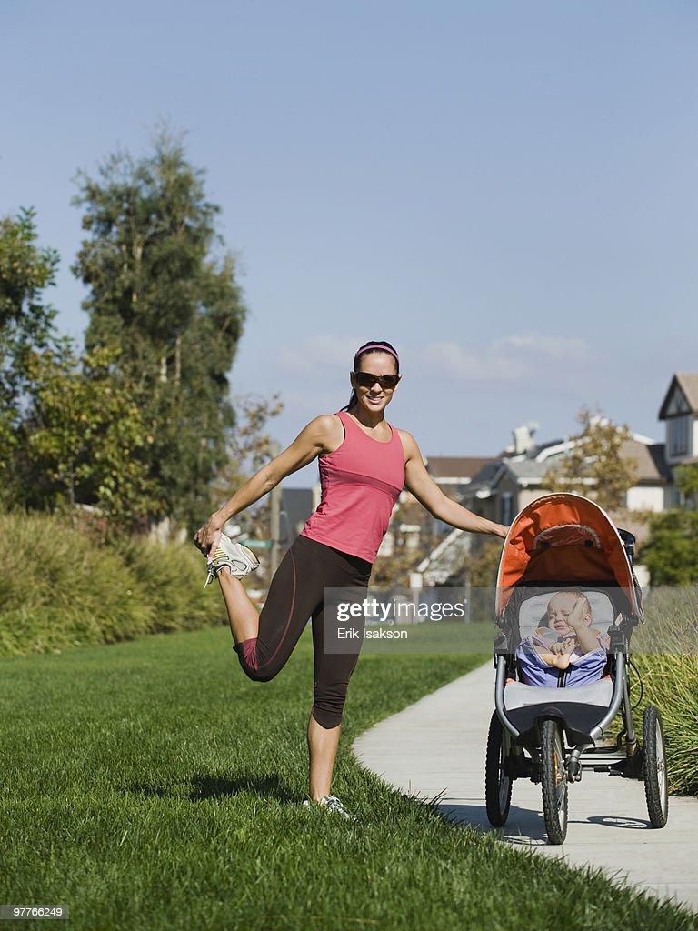 Jogger and baby : Stockfoto