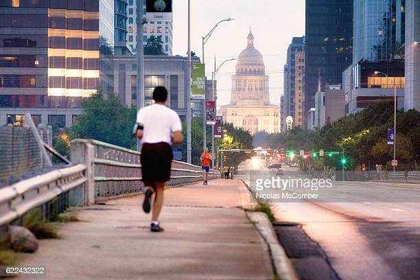 Jogger at dawn running in Austin Texas