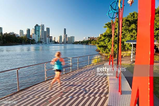 jogger & brisbane skyline, queensland, australia - brisbane stock pictures, royalty-free photos & images