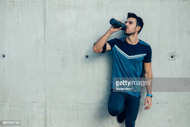 jogger drinking water - sportsperson stock pictures, royalty-free photos & images
