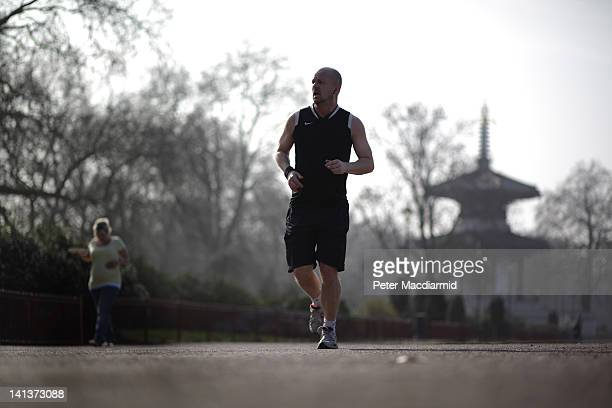 A jogger enjoys the spring sunshine in Battersea Park on March 15 2012 in London England Parts of the United Kingdom are enjoying the warmest day of...