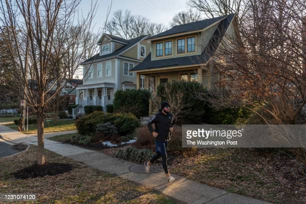 Jogger exercises in the Lyon Park neighborhood of Arlington, VA, on February 08, 2020.