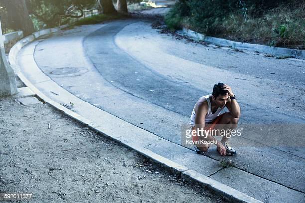 jogger exhausted, taking break, arroyo seco park, pasadena, california, usa - struggle stock pictures, royalty-free photos & images