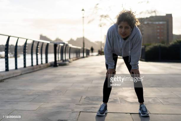 jogger feeling tired after running outdoors - jogging stock pictures, royalty-free photos & images