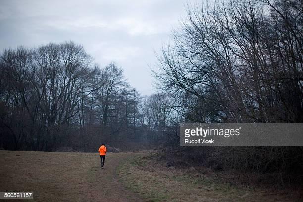 Jogger (runner) inorange reflective vest
