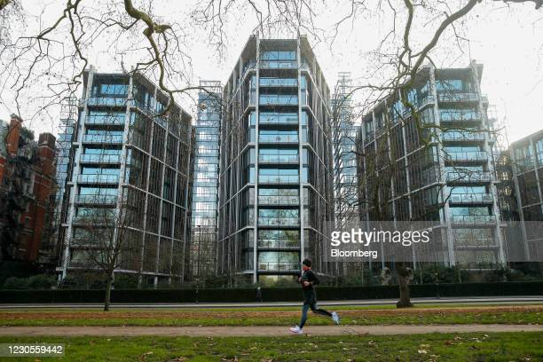 Jogger passes One Hyde Park, a luxury residential and retail complex, in Knightsbridge, London, U.K., on Thursday, Jan. 7, 2021. Persimmon Plc, the...